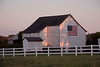 White Barn and Flag at Dusk