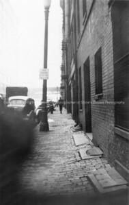 R15-street_scene-nlg-circa03jun1938-5181 stamp on back of original print shows it was processed on 03jun1938 by 'pieritz bros photo service'