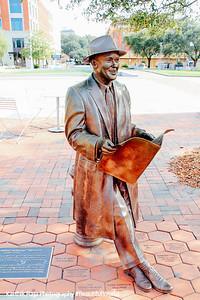 Man reading a magazine, statue, Ellis Square, Savannah, Georgia