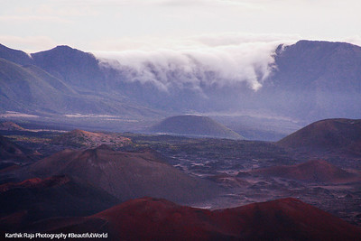 Clouds flowing over the peaks, Haleakala National Park, Maui, Hawaii, USA