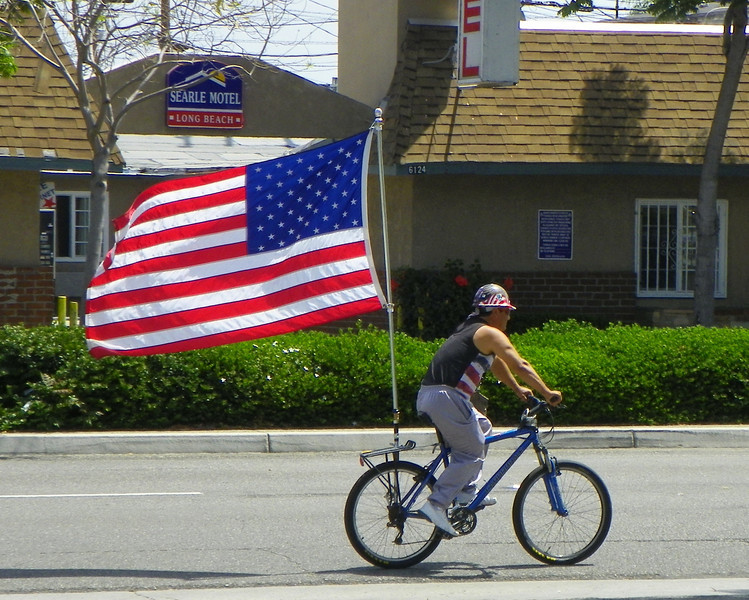 Riding a bicycle with an American flag on it has become common - http://www.americabikes.org/patriotic_bikes_aplenty
