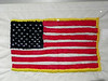 The white background is a handkerchief from prisoner Tom Strumpter.<br /> The red stripes were made from a pair of red shorts from prisoner Robert Daughtrey (died 2005).<br /> The blue background of the stars is from a jacket provided by the North Vietnamese.<br /> The white stars were embroidered by Duffy Hutton using threads from a towel.<br /> The gold embroidery is threads from a blanket.<br /> The red stripes are thread from a handerchief from Ken Simonet (died 2014).