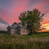 Beautiful sunset over an abandoned one room schoolhouse in rural Iowa