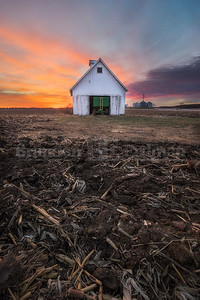 Beautiful sunset over a corn crib near Geneseo, IL