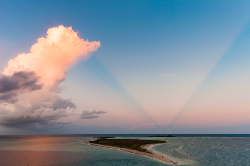 A stunning sunset with anti-crepuscular rays from the top of Fort Jefferson, looking out towards Bush Key in the Dry Tortugas, FL.