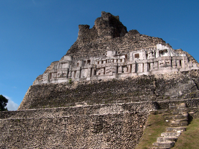 Castillo, Xunantunich, Belize.  This small site near the border with Guatemala includes a huge frieze on the eastern and western faces of the structure.  The three faces depicted here may represent gods or royal ancestors.