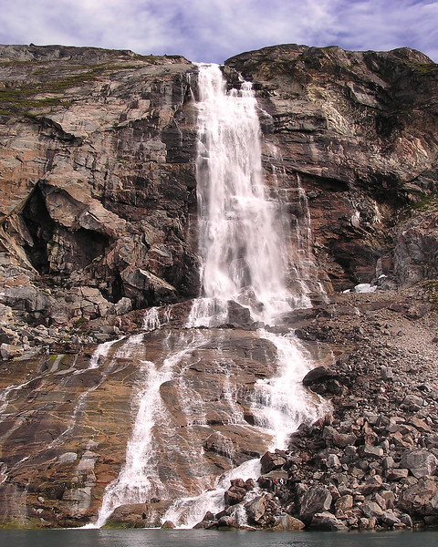 This waterfall sits between Eki and Ilulissat.  For a sense of scale, note the two tiny figures at the bottom, just to the right of the water.