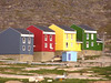 Houses, Ilulissat.  Almost all houses are prefab, and in primary colors.  They are built on solid rock, so the plumbing pipes run aboveground down the hills.
