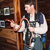 Scott Happily Holds a Pet Kingsnake in Belize