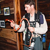 Scott Happily Holds a Pet Kingsnake in Belize