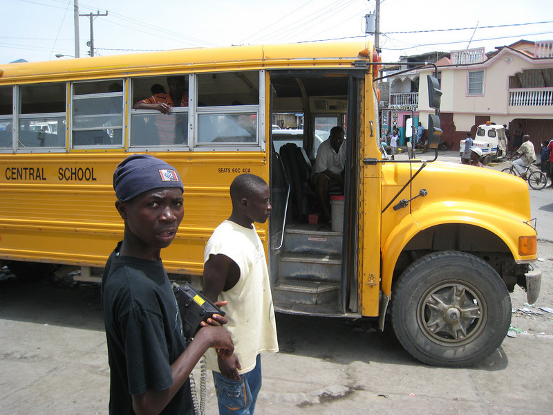 A bus for travelling home.  The boy in the picture is holding a cordless telephone which functions as a phonebooth - you pay him to make calls around the country.