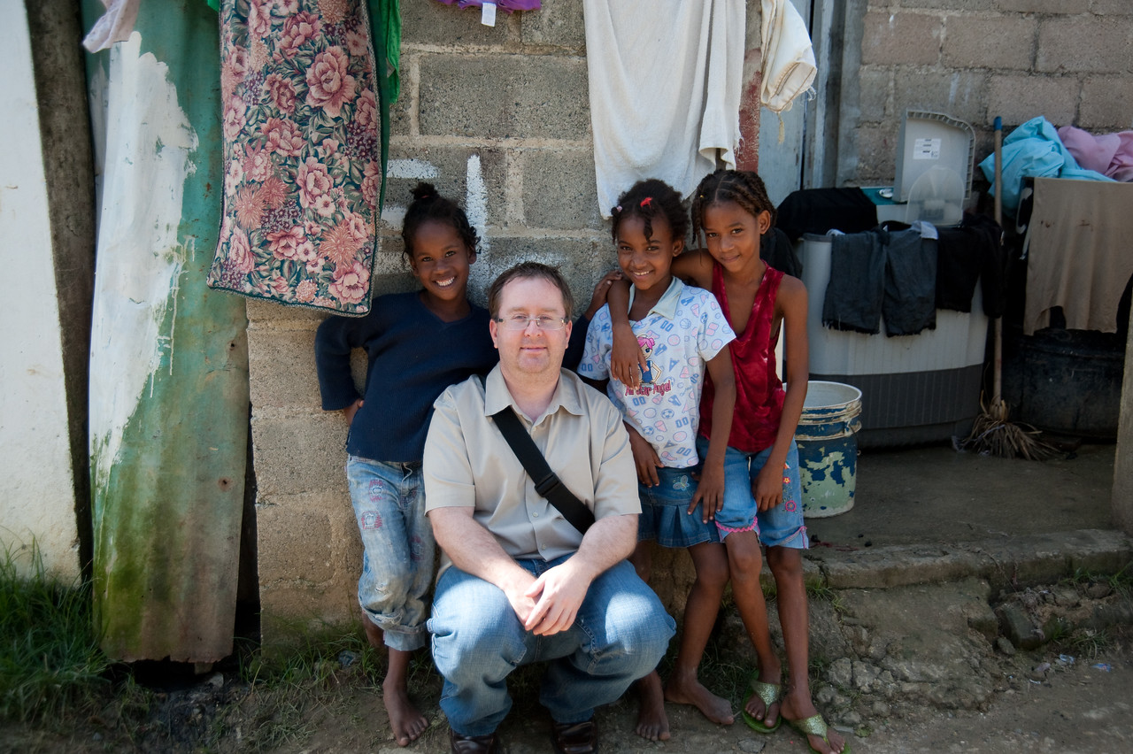 Me sitting with some of the kids of a microfinanced family.