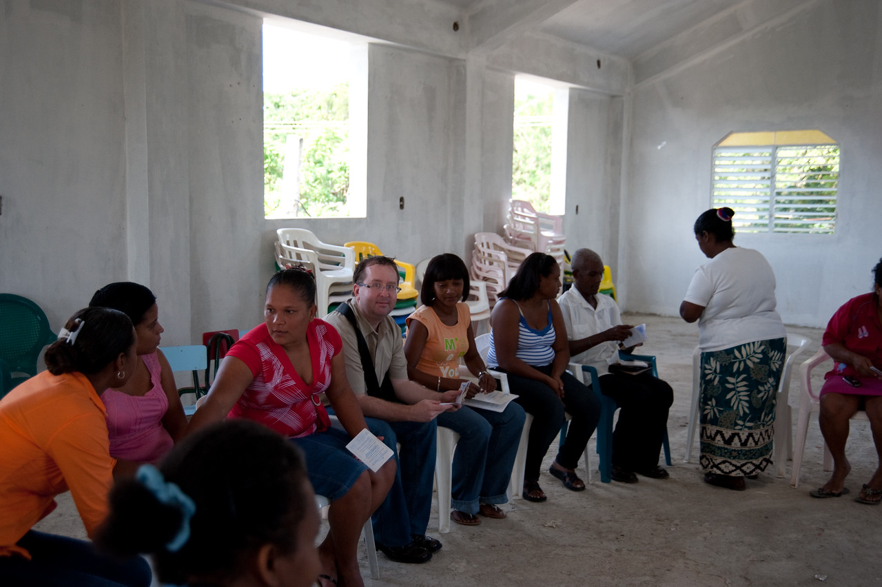 """This was a second microfinance meeting and I am sitting with """"my"""" loan book as the other members do."""