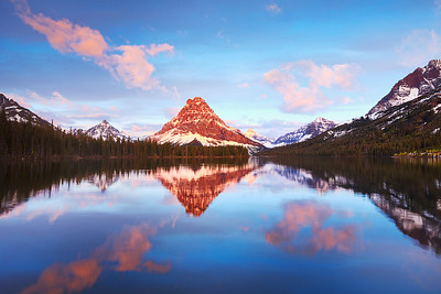 Mount Sinapah reflected over Two Medicine Lake in Glacier National Park, Montana, USA during sunrise