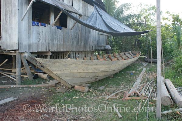 Amazon River - Village of San Jose de Parandpura - Carpenter House with boat