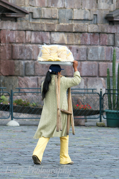 Woman carrying food for sale, Quito, Ecuador