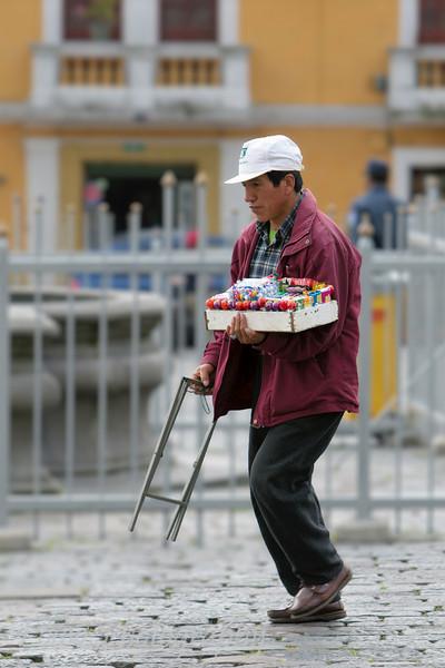 Man carrying goods for sale, Quito, Ecuador