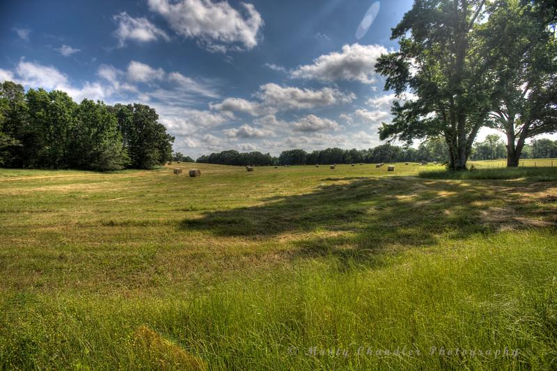Fresh hay bales under an Oklahoma sun.