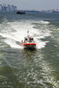 Coast Guard following the Staten Island Ferry with a .50 Caliber machine gun..  Seriously?