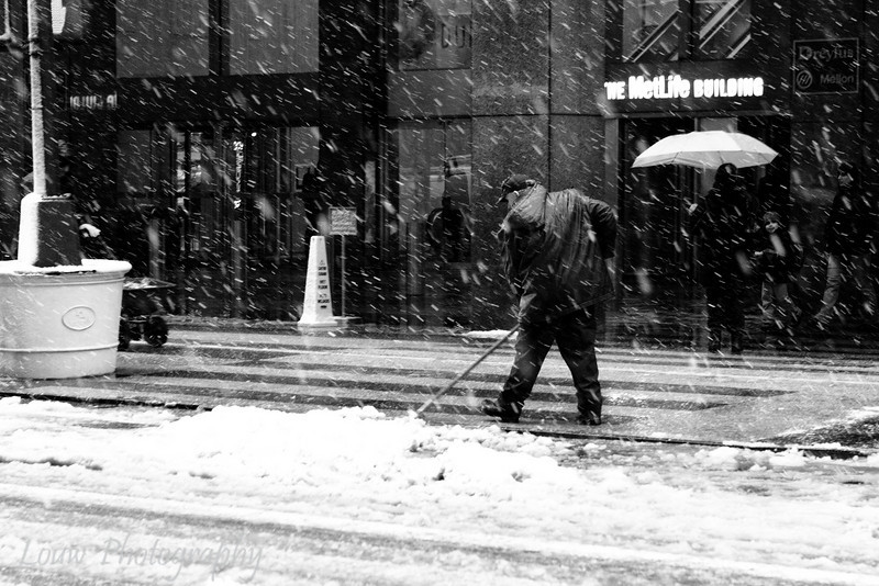 Squeegeeing the snow, New York, NY