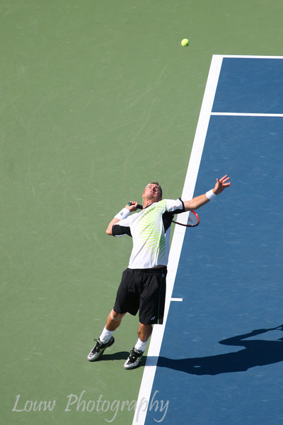 Lleyton Hewitt serves at the 2009 U.S. Open Round 3 vs. Roger Federer. September 5, 2009.