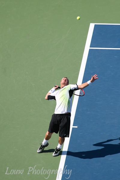 Lleyton Hewitt serves at the 2009 U.S. Open Round 3 vs. Roger Federer. September 5, 2009.