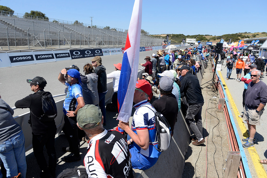. Hundreds of people line the Stage 3 finish at Laguna Seca Raceway in Monterey on Tuesday, May 15, 2018 during the Amgen Tour of California.  (Vern Fisher - Monterey Herald)
