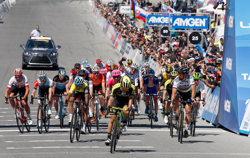 . Riders cross the finish line after Toms Skujins from Latvia rode to victory during the Stage 3 at Laguna Seca Raceway in Monterey on Tuesday, May 15, 2018 during the Amgen Tour of California.  (Vern Fisher - Monterey Herald)