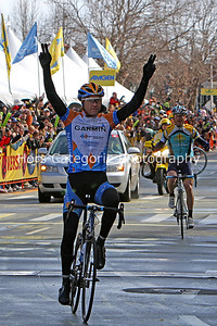 1148 Tom Peterson still celebrating as Levi Leipheimer begins to celebrate taking the yellow overall leader's jersey