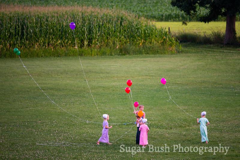 Amish Children Flying Balloons