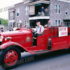 "Bill driving his fire truck, originally owned by Bigelow Sanford Carpet Mills ""HOSE CO. No 1"""