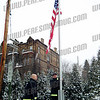 "AFD firefighters Rob Shang and Ken Brooks lower the American flag to half mast in front of the firehouse on 1/18/11 to honor the passing of Ret.FF Bill ""Tex"" Armstrong"