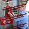 Amsterdam firefighter Tim Miller tests the call box in front of the Amsterdam Fire Department Headquarters in the Public Safety Building that has recently been connected directly to the Montgomery County E-911 Dispatch Center.<br /> <br />  <br /> <br /> The old Gamewell fire alarm pull box has been out of service since the late 1990's, and now, with a push of a button, a citizen can call a 911 dispatcher to report an emergency through the new automatic dialer.