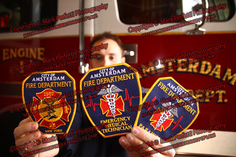 Amsterdam firefighter Rob Krygowski displays the new patches he designed for Amsterdam Fire