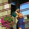 Amsterdam firefighter Bob Shang waters the flowers in front of the station on Memorial Day