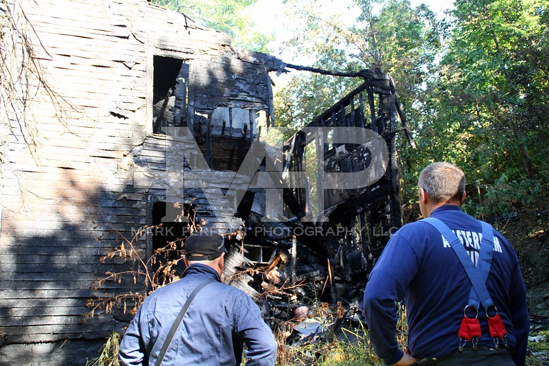 Amsterdam firefighters survey the damage on the structure at 30 Cady Street on Saturday morning