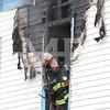 Amsterdam Fire Lieutenant Tim Miller checks for fire extension