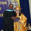 AHS Principal Tyrone O'Meally with graduate Sandra Elizabeth Zelaya
