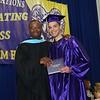 AHS Principal Tyrone O'Meally with graduate Damian Zapata