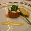 Parfait of tuna and salmon tartares with crostini, creme fraiche, and caviar