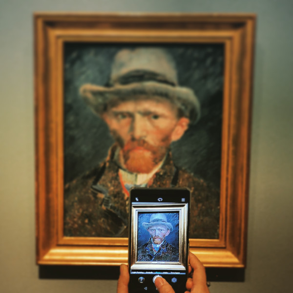 A photo of a photo of a Van Gogh selfie. 2016.