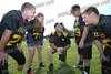 Steelers Asst. Coach Jason Fiet talks to his players David Zwack(11) Kayla Traskos(12) Jason Gonzalez(10) and Jake Fiet(11)