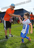 Griffin Cozzocrea (7) accepts his participation medal from Sr Division Pres. Bill Pereicich as part of the NFL Flag Football program