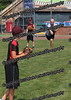 pitcher Sean Bouthilette shows Riley Mykel(foreground) and Trevor Porter, 10, Gloversville proper pitching technique