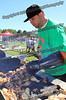 Green Gators Asst Coach Jeff Van Allen cooks the chicken