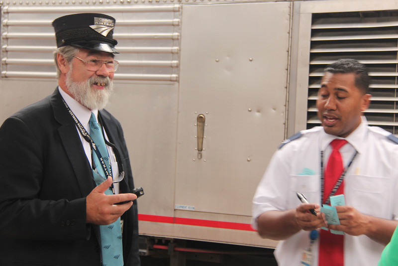 Robert Baker and Train Attendant