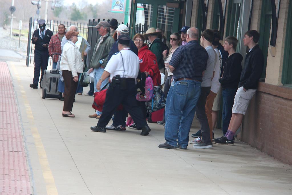 Conductors David E. Mayo and Wilborn Phillips prepare to load passengers at Mineola, TX.