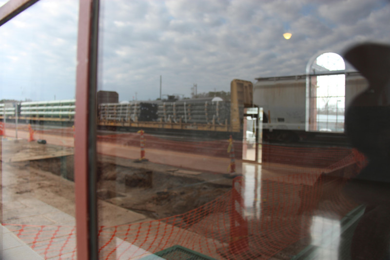 A UPRR Freight Train is shown reflected in the new Amtrak Waiting Room Windows.