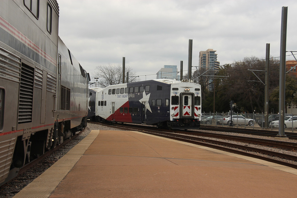 #21 has arrived at Dallas.  A Trinity Railway Express (TRE) Commuter Train enters the Depot.