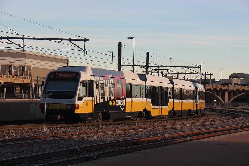A Dallas Area Rapid Transit (DART) Commuter Train is shown leaving Dallas Union Station.<br /> (Photo by William A. Shaffer)